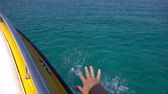 chipre : Male hand above turquoise sea water. POV shot from motor boat Vídeos