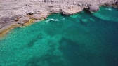 ragged : Rocky shore of clear Adriatic sea. Sea bottom is vidible through turquoise water. Aerial shot