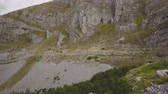 tableland : Looking to the top of rocky summit in Montenegro mountains. Vertical pan Stock Footage