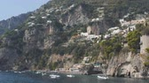 watercraft : White mediterranean villages on slopes ща mountain. View from sea. Lots of boats along shore