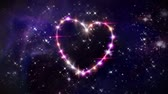 flirting : starry night in space background with heart forming from stars Stock Footage