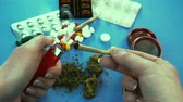 ジョイント : Marijuana joint. Pills are on the background 動画素材