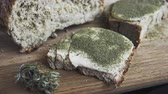 sandviç : Close-up of bread with hemp flour, sandwich with cannabis butter and hashish. Concept of using marijuana in the food industry Stok Video