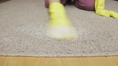 bacterial : Woman in yellow rubber gloves cleaning carpet with a sponge and foam Stock Footage