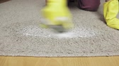 bacterial : Woman in yellow rubber gloves cleaning carpet with a brush and foam