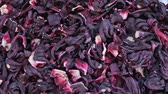 calyx : Dry hibiscus flowers tea rotation texture background from Sudanese rose, karkade