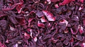hibisco : Dry hibiscus flowers tea rotation texture background from Sudanese rose, karkade