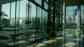 tower : Luxury mall glass house,hall,Tower,overlooking,pots,fashion,wealth,Sun,shadow. Stock Footage