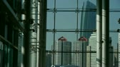 upscale : Luxury mall glass house,hall,Tower,overlooking,pots,fashion,wealth,Sun,shadow. Stock Footage