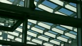 upscale : Roof of luxury mall glass house,Geometry,composition,monitor camera.
