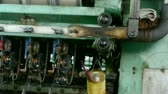 thread warping : Reeling machine and Textile machine in operation.Bearings,screws,bolts.