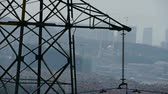 wind breaker : High-voltage wire tower in urban city,wind tree,distant mountain & hill. Stock Footage