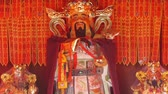 buddhista : Chinese God sculpture of wealth,Red sign make wish.