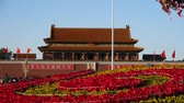 parterre : soldier&officer through Parterre full of flowers.Beijing Tiananmen Square.
