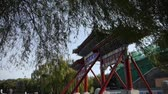historický : swing willow & orient ancient Memorial arch in beijing china.