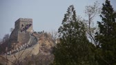 battlements : visitor climbing Great Wall on mountain peak,China ancient architecture,fortress.