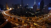 yanan : Aerial View of freeway busy city rush hour heavy traffic jam highway,shanghai Yanan East Road Overpass interchange,moving the lens,Brightly lit modern urban building.