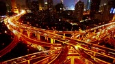 yanan : Aerial View of freeway busy city rush hour heavy traffic jam highway,shanghai Yanan East Road Overpass interchange,time lapse,Brightly lit modern urban building.