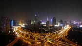 yanan : Aerial View of freeway busy city rush hour heavy traffic jam highway,shanghai Yanan East Road Overpass interchange,driving & cars racing by with streaking lights trail at night with super long exposures for each frame.