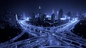 intersection : Aerial View of freeway busy city rush hour heavy traffic jam highway,shanghai Yanan East Road Overpass interchange,driving racing by with streaking lights trail with super long exposures. Stock Footage