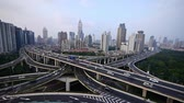 yanan : time lapse,Aerial View of freeway busy city rush hour heavy traffic jam highway,shanghai Yanan East Road Overpass interchange,urban building.