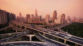 yanan : time lapse,Aerial View of freeway busy city rush hour heavy traffic jam highway,shanghai Yanan East Road Overpass interchange,urban building sunset.