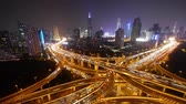 intersection : Aerial View of freeway busy city rush hour heavy traffic jam highway,shanghai Yanan East Road Overpass interchange at night,driving racing by with streaking lights trail with super long exposures.