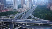 yanan : time lapse,heavy traffic on highway interchange,Aerial View of Shanghai Skyline.z1 x2 c3=time lapse,Aerial View of freeway busy city rush hour heavy traffic jam highway,shanghai Yanan East Road Overpass interchange,urban building sunset.