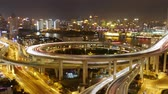 intersection : Timelapse,driving & cars racing by with streaking lights trail on overpass at night in shanghai,super long exposures for each frame,Brightly lit urban building,busy shipping sailing on huangpu river. Stock Footage