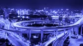 intersection : Timelapse of driving & cars racing with streaking lights trail on overpass bridge at night in shanghai with super long exposures for each frame,Brightly lit urban morden building,busy shipping on huangpu river. Stock Footage