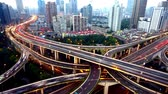 yanan : Aerial View freeway busy city rush hour heavy traffic jam highway,shanghai Yanan Road Overpass interchange,driving & cars racing by with streaking lights trail with super long exposures for each frame from day to night.