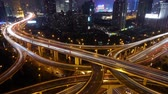 yanan : Aerial View of freeway busy city rush hour heavy traffic jam highway at night,shanghai Yanan East Road Overpass interchange,driving & cars racing by with streaking lights trail with super long exposures for each frame.
