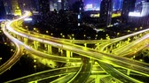 yanan : Timelapse of freeway busy city rush hour heavy traffic jam highway Shanghai at night,Yanan East Road Overpass interchange,the light trails of traffic with super long exposures,Brightly lit urban morden building.