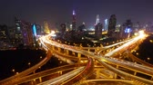 Timelapse of freeway busy city rush hour heavy traffic jam highway Shanghai at night,Yanan East Road Overpass interchange,the light trails of traffic with super long exposures,Brightly lit urban morden building.