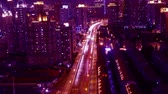 intersection : freeway busy city rush hour heavy traffic jam highway Shanghai at night,the light trails of traffic with super long exposures for each frame,timelapse,Brightly lit urban morden building. Stock Footage