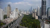 yanan : time lapse,Aerial View of freeway busy city rush hour heavy traffic jam highway,shanghai Yanan East Road Overpass interchange,modern business skyscraper building,urban green space,,orient pearl tower. Stok Video