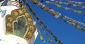 shangrila : 4k buddhist white stupa and flying prayer flags