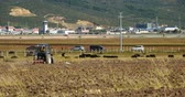 shangrila : 4k tibetan people use farm tractor on the arable land