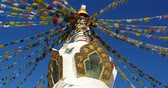 shangrila : 4k buddhist white stupa & flying prayer flags with blue sky background, Shangrila, Yunnan, China. Stock Footage
