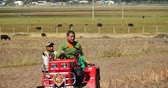 shangrila : 4k Tibetan use farm tractor to plough the arable land in Shangrila, Yunnan, China. Stock Footage