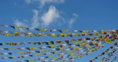 shangrila : 4k buddhist white stupa & flying prayer flags with blue sky background, Shangri-la, Yunnan, China.