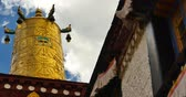 spirit : closeup of The Jokhang Temple In Lhasa,Tibet,white clouds in blue sky. Stock Footage
