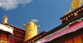 meditation : closeup of The Jokhang Temple In Lhasa,Tibet,white clouds in blue sky. Stock Footage