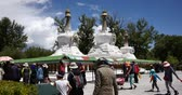 offers : tibet people turn spinning buddhist prayer wheels,Potala & the ancient white stupa.