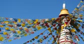 spirit : buddhist white stupa & flying prayer flags with blue sky background,shangrila yunnan,china.