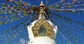 shangrila : buddhist white stupa & flying prayer flags with blue sky background,shangrila yunnan,china.