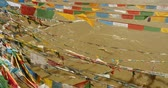windy : prayer flag on lhasa river,tibet. Stock Footage