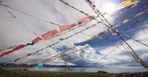 roof : huge clouds mass rolling over lake namtso & Tanggula snow mountain peak,tibet mansarovar,pray flag in wind,Tibets second largest lake,is the third largest saltwater lake in China.Danggula(Tanggula) Mountains in xizang Plateau,roof of the World. Stock Footage