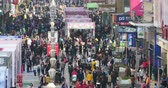businness : timelapse Huge Crowd Of People walking on china business street,QingDao. Stock Footage
