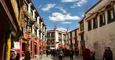 roof : tibetan & tourist walking on famous barkhor street in lhasa,tibet,butter store.